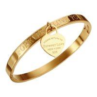 Ατσάλινη Χειροπέδα Σε Χρυσό Με Κρεμαστή Καρδούλα